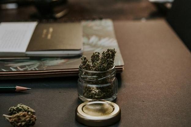 cannabis in a jar on a desk